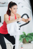 Attractive young woman using step machine at home. Attractive young woman using a step machine at home Stock Images