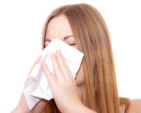 Attractive young woman using tissue Stock Images