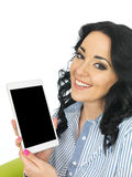 Attractive Young Woman Using a Wireless Tablet Stock Photography