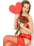 Attractive Young Woman in Valentines Pin Up Lingerie Holding Rose Stock Photos