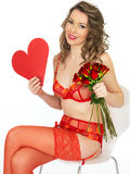 Attractive Young Woman in Valentines Pin Up Lingerie Holding Rose Stock Photo
