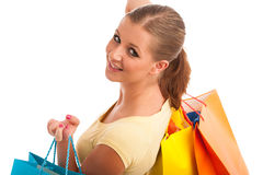Attractive young woman with vibrant shopping bags isolated Stock Photo