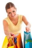 Attractive young woman with vibrant shopping bags isolated Royalty Free Stock Images