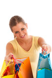 Attractive young woman with vibrant shopping bags isolated Stock Image