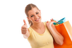 Attractive young woman with vibrant shopping bags isolated over Stock Photography