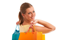 Attractive young woman with vibrant shopping bags isolated Royalty Free Stock Photos