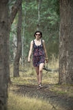 Attractive young woman walking in bush Royalty Free Stock Image