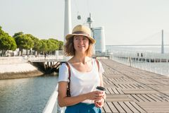 Attractive young woman walking in Lisbon near Tajus river at Park of the Nations Royalty Free Stock Images