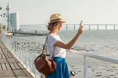 Attractive young woman walking in Lisbon near Tajus river at Park of the Nations Stock Photos