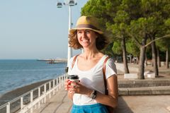 Attractive young woman walking in Lisbon near Tajus river at Park of the Nations Stock Images