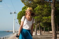 Attractive young woman walking in Lisbon near Tajus river at Park of the Nations Royalty Free Stock Photos