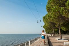 Attractive young woman walking in Lisbon near Tajus river at Park of the Nations Stock Image