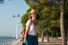 Attractive young woman walking in Lisbon near Tajus river at Park of the Nations Royalty Free Stock Image