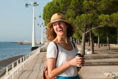 Attractive young woman walking in Lisbon near Tajus river at Park of the Nations Stock Photo