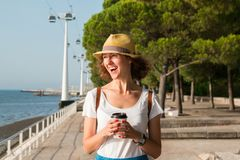Attractive young woman walking in Lisbon near Tajus river at Park of the Nations Stock Photography