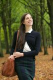 Attractive young woman walking and smiling outdoors Royalty Free Stock Photography