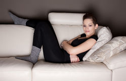 An attractive young woman watching TV Stock Photo