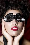 Attractive young woman wearing a black gem mask Stock Photography