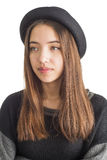 Attractive young woman wearing black hat Royalty Free Stock Image