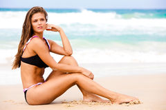 Attractive Young Woman Wearing a Black Swimsuit Royalty Free Stock Image