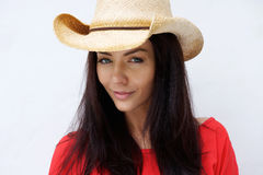 Attractive young woman wearing cowboy hat. Close up portrait of an attractive young woman with cowboy hat looking at camera Stock Image