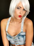 Attractive Young Woman Wearing Dungarees Posing Royalty Free Stock Photos