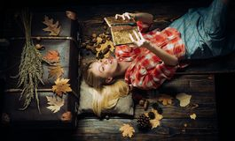 Attractive young woman wearing in fashionable seasonal clothes having Autumnal mood. Happy young woman preparing for. Autumn sunny day. Sensual woman wearing stock photography