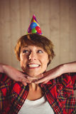 Attractive young woman wearing hat party. On wooden planks background Royalty Free Stock Image