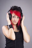 Attractive young woman wearing headphones Stock Images