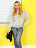 Attractive Young woman Wearing Jeans and a Jumper Royalty Free Stock Photo