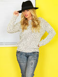 Attractive Young woman Wearing Jeans and a Jumper Stock Images