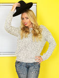 Attractive Young woman Wearing Jeans and a Jumper Royalty Free Stock Photos