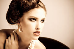Attractive Young Woman Wearing Pearls Royalty Free Stock Photos