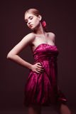 Attractive young woman wearing on pink dress. Attractive young woman with naked shoulders wearing on pink dress Stock Images