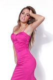 Attractive young woman wearing a pink dress Royalty Free Stock Photo
