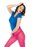 Attractive Young Woman Wearing Pink Tights and Short Blue Mini D Stock Images