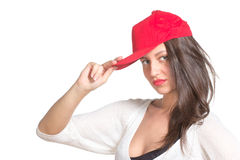 Attractive young woman wearing a red baseball cap Royalty Free Stock Image
