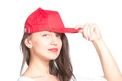 Attractive young woman wearing a red baseball cap. Isolated Stock Photos