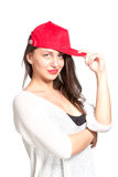 Attractive young woman wearing a red baseball cap Stock Photography