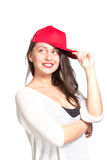 Attractive young woman wearing a red baseball cap Stock Photos