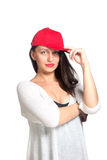 Attractive young woman wearing a red baseball cap. Isolated Royalty Free Stock Photo