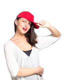 Attractive young woman wearing a red baseball cap Royalty Free Stock Photos