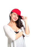 Attractive young woman wearing a red baseball cap. Isolated Stock Photo