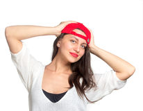 Attractive young woman wearing a red baseball cap Stock Images