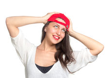Attractive young woman wearing a red baseball cap. Isolated Royalty Free Stock Images
