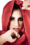 Attractive Young Woman Wearing a Red Shawl Royalty Free Stock Image