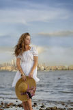 Attractive young woman wearing romantic white dress Royalty Free Stock Photography