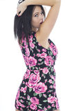 Attractive Young Woman Wearing a Short Floral Plays suite Stock Photography