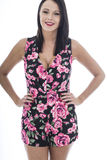 Attractive Young Woman Wearing a Short Floral Playsuit Stock Images