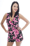 Attractive Young Woman Wearing a Short Floral Playsuit Stock Photos